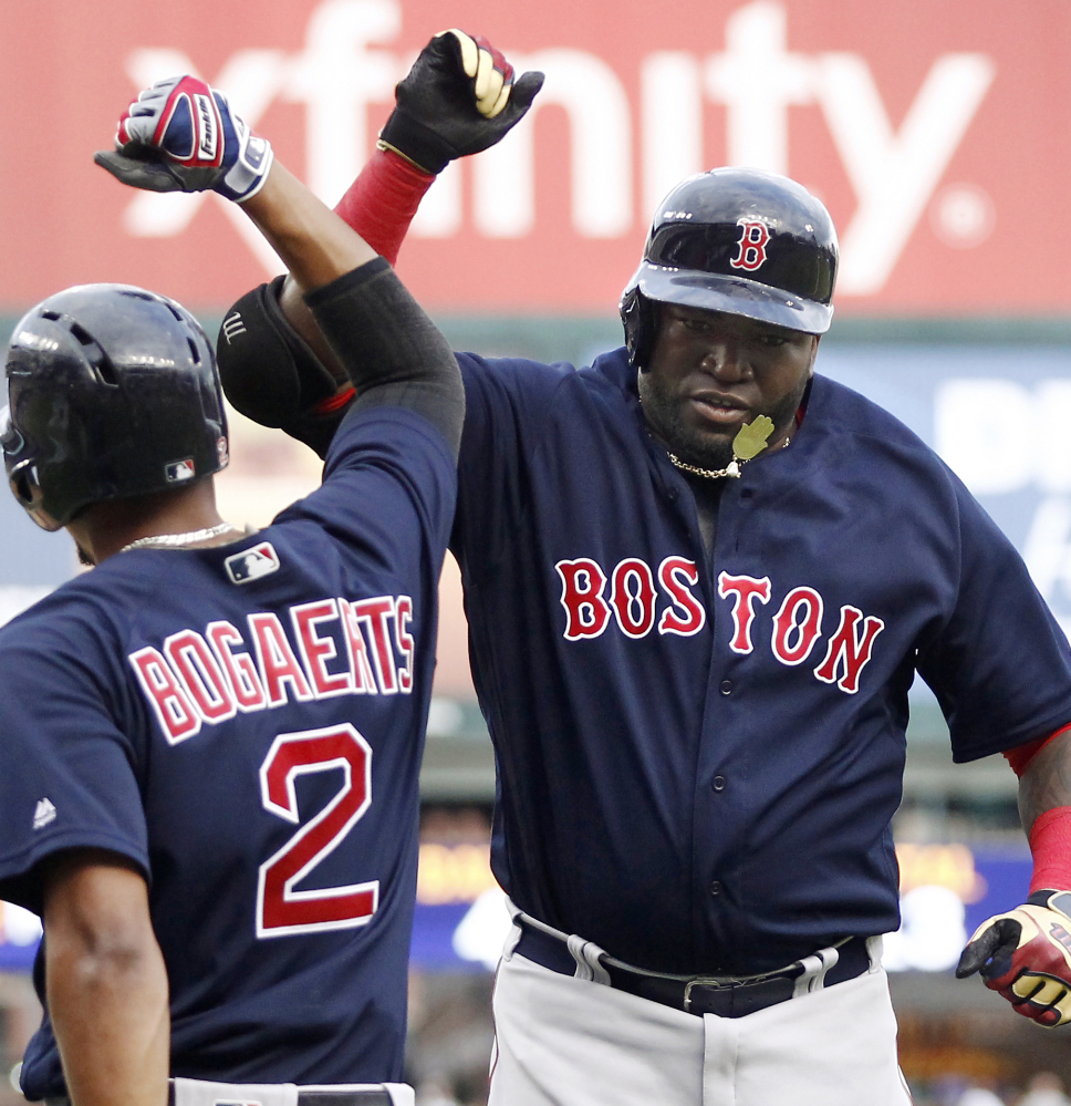 Boston's David Ortiz, right, celebrates with Xander Bogaerts after his two-run homer in the first inning that started the Red Sox on the way to a 10-2 rout against the host Detroit Tigers.