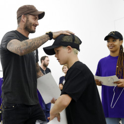 David Beckham and his son Cruz shop together at Kanye West's pop-up shop on Friday in Los Angeles.