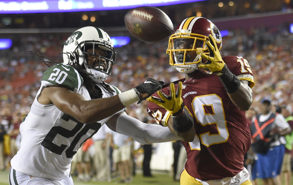 New York Jets cornerback Marcus Williams can't stop a touchdown catch by Washington wide receiver Rashad Ross during the first half of Friday's preseason game in Landover, Md., won by Washington,  22-18.