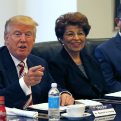 Republican presidential candidate Donald Trump holds a Hispanic advisory meeting in New York on Saturday. With him are Jovita Carranza, former Small Business Administration deputy administrator, and Joseph Guzman, president of the American Society of Hispanic Economists.
