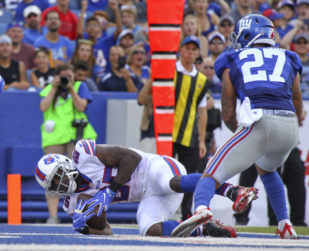 Buffalo running back LeSean McCoy catches a touchdown pass against Giants safety Darian Thompson during the Bills' 21-0 preseason win Saturday in Orchard Park, N.Y.