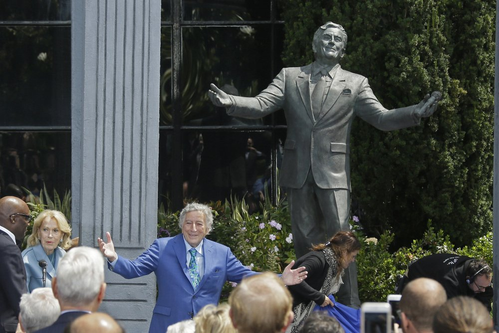 Tony Bennett gestures after his statue is unveiled outside the Fairmont Hotel in San Francisco on Friday. He turned 90 on Aug. 3.