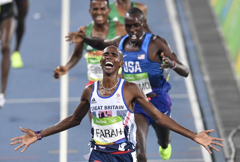 Britain's Mo Farah wins the gold medal in the men's 5,000 meters, finishing just ahead of surprise silver medalist Paul Chelimo of the United States.