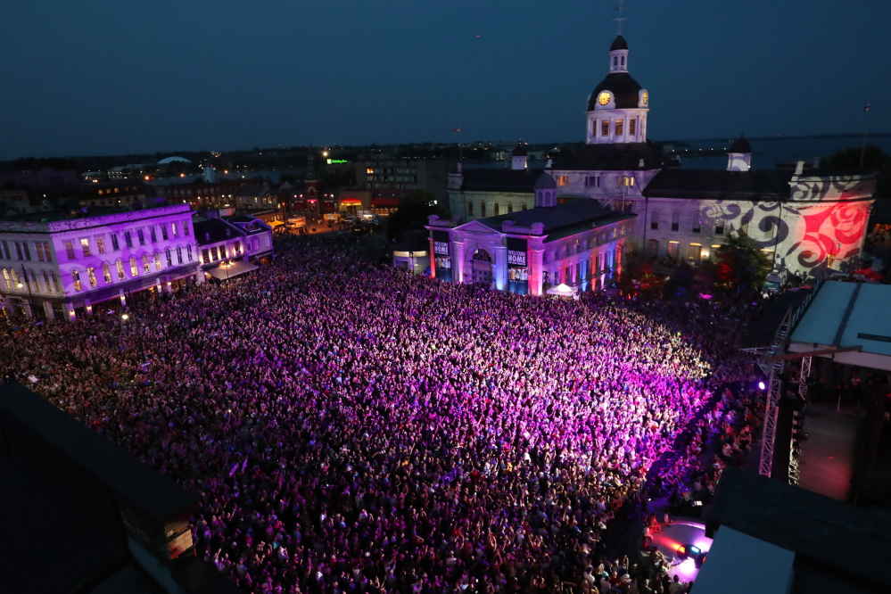 People who could not get a ticket gather to listen to the Tragically Hip in downtown Kingston, Ontario, on Saturday. The Tragically Hip mixed fan favorites, newer songs and some politics during the final show of their