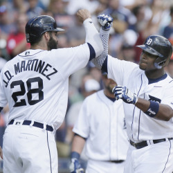 Tigers' Justin Upton, right, celebrates with J.D. Martinez after hitting a three-run homer against the Boston Red Sox during the third inning Sunday in Detroit.