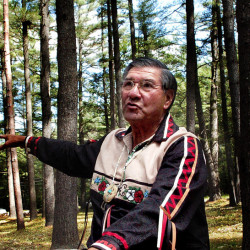 Penobscot tribe elder Butch Phillips speaks prior to a ceremony honoring ancestors Sunday in The Pines area off Father Rasle Road in Madison, where Native Americans were massacred in 1724.