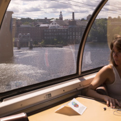 "Kerstin Egenhofer rides in an original 1955 dome observation car while traveling from Boston on the Downeaster to spend a day off of work in the Portland area. ""I wanted to make an experience out of my trip,"" Egenhofer said. ""This put the bow on it."""