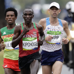 Eliud Kipchoge of Kenya leads Feyisa Lilesa of Ethiopia and Galen Rupp of the U.S. late in the marathon before pulling away to win in a time of 2 hours, 8 minutes, 44 seconds. Lilesa took the silver medal and Rupp won bronze.