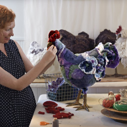 In her studio in Kansas City, artist Sally Jane Linville works on one of her felted wool footstools, that come in the form of a chicken. Each one is unique and has its own name.    Rich Sugg/Kansas City Star/TNS