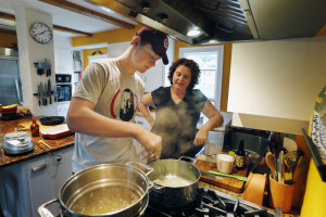 Christine Burns Rudalevige talks her son Owen through making a béchamel sauce for mac and cheese at their home in Brunswick.