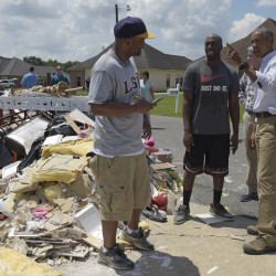 President Obama talks with residents as he tours Castle Place, an area of Baton Rouge, La., Tuesday. Obama has been criticized for not visiting the state sooner.