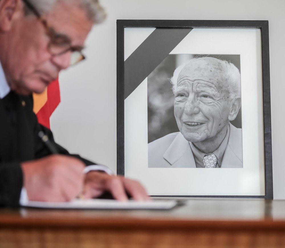 German president Joachim Gauck writes a condolence for former president Walter Scheel Wednesday in Berlin. In the '70s, Scheel battled the Red Army Faction's terrorism.