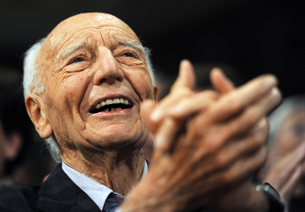 FILE In this Nov. 14, 2011 former West German president  Walter Scheel applauds  during an event in Berlin. Walter Scheel, who helped shape West Germany's policy of reconciliation with the communist bloc as foreign minister and later served as his country's president, has died Wednesday Aug. 24, 2016. He was 97.  (P,file)