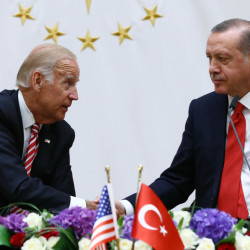 U. S. Vice President Joe Biden, left, and Turkish President Recep Tayyip Erdogan shake hands Wednesday in Ankara, Turkey, where Biden reiterated the commitment of both countries to defeat the Islamic State.