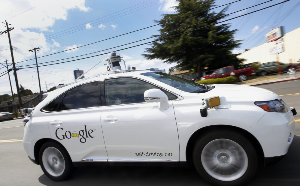 FILE - In this May 13, 2015, file photo, Google's self-driving Lexus drives along a street during a demonstration at Google campus in Mountain View, Calif. While the Boston region is a center for robotics and artificial intelligence research, none of the Northeast states allows self-driving cars to be driven or tested on public roads. But Massachusetts officials are looking in 2016 at turning part of the former Devens military base into a self-driving testing ground. (AP Photo