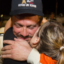 Glen Luce of Turner hopes to receive another winning hug after this year's Oxford 250 on Sunday. Luce said he prefers sneaking in under the radar.