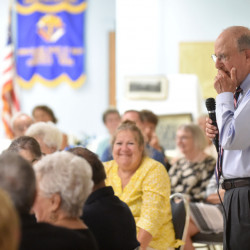 Former U.S. Sen. George Mitchell pauses as he speaks Wednesday during an endowment fund dinner at his childhood church, St. Joseph Maronite Catholic Church, in Waterville.