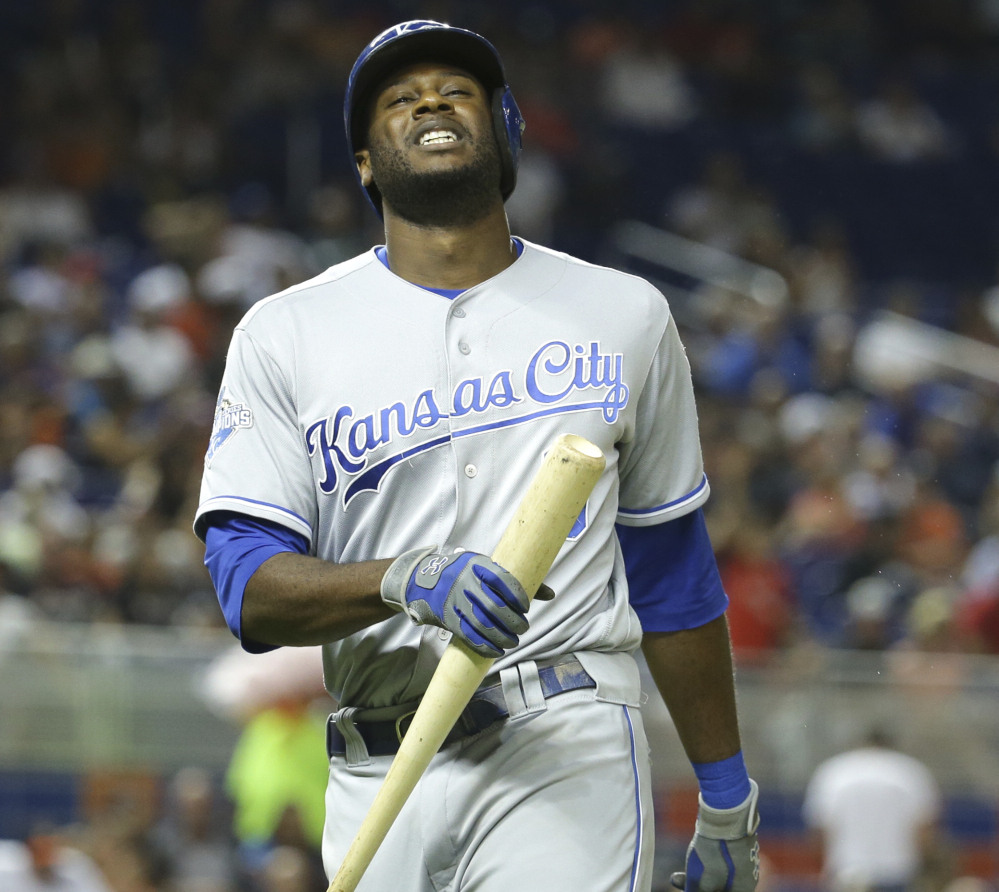 Kansas City's Lorenzo Cain returns to the dugout after lining out to second in the sixth inning of a 3-0 loss to the Marlins Wednesday at Miami.