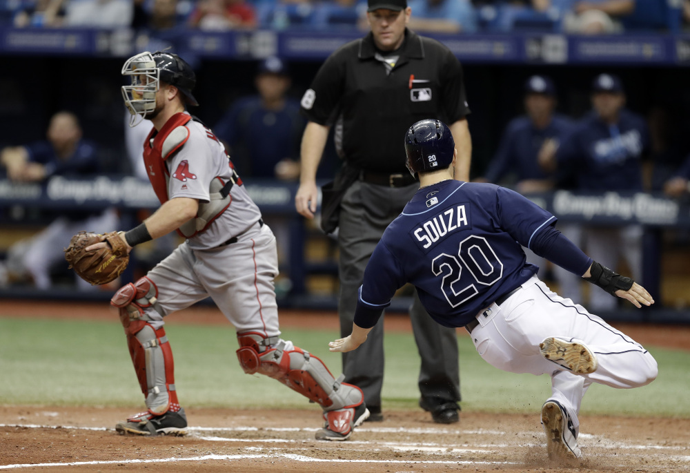 The Rays' Steven Souza Jr. slides home safely on a double by Mikie Mahtook, scoring what proved to be the winning run in the seventh inning of a Thursday's game in St. Petersburg, Fla.