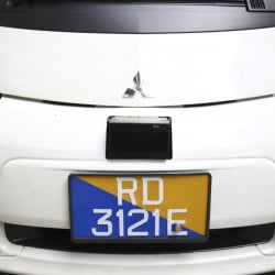 A Lidar, shown above the license plate of an autonomous vehicle in Singapore on Wednesday, detects obstacles using laser sensors. Each test car is fitted with six sets of the devices.