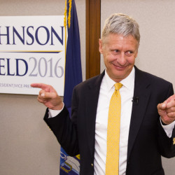 Former New Mexico governor and Libertarian presidential candidate Gary Johnson gestures to supporters after a campaign speech at the Portland Regency Friday.