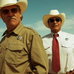 "Jeff Bridges, left, as Texas Ranger Marcus Hamilton and Gil Birmingham as his partner Alberto Parker in ""Hell or High Water."""