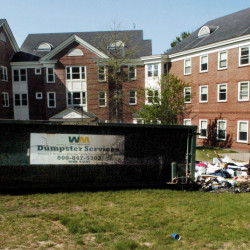 A dumpster loaded with items from Colby College students was damaged by fire May 22 outside the Alfond dormitory on the campus in Waterville. The Kennebec County district attorney said this week that the office is closer to charging former students in the fire.