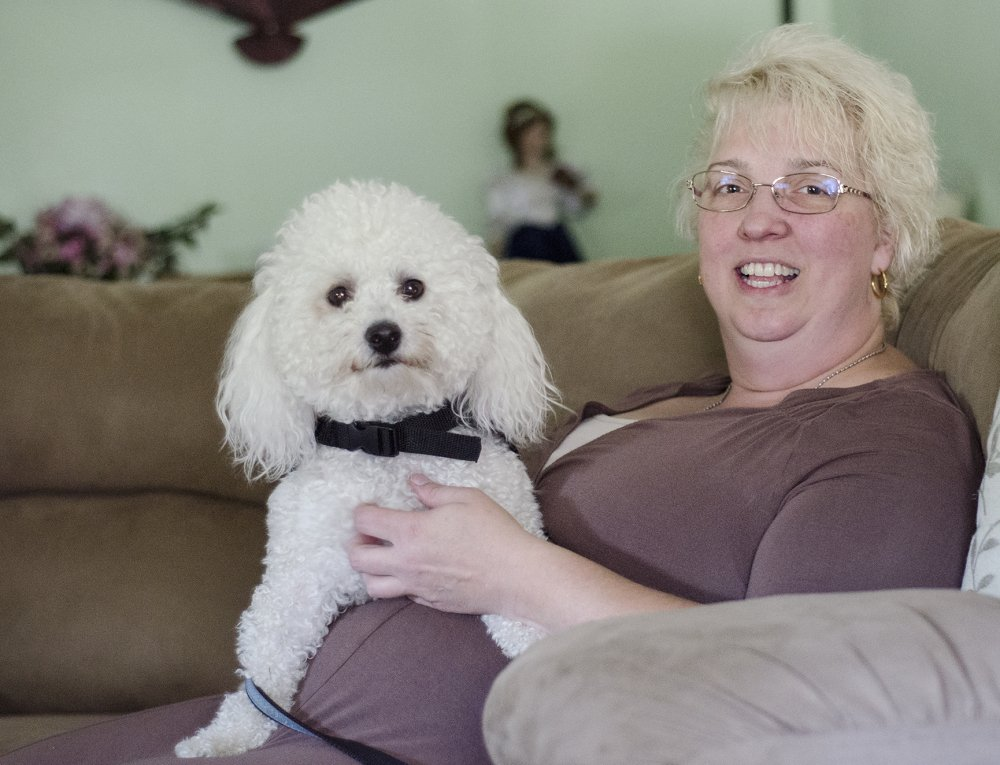 Fitchburg, Mass., resident Lorelei McClure has her own Prince Charming in the form of a 10-inch tall Bichon Frise trained to respond when she's suffering a seizure.