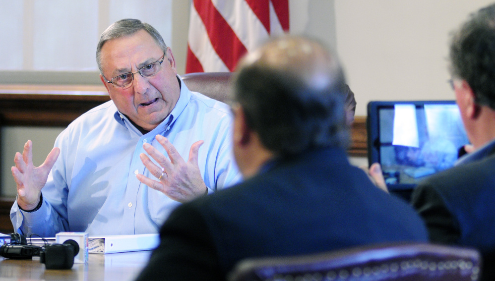 Gov. LePage defends his racial profiling and threats of violence against a state lawmaker in a meeting with reporters Friday.
