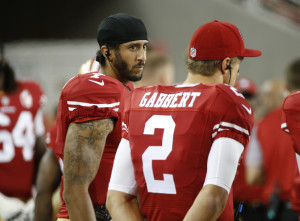San Francisco 49ers quarterbacks Colin Kaepernick, left, and Blaine Gabbert stand on the sideline during an NFL preseason football game against Green on Friday in Santa Clara, Calif. Kaepernick refused to stand for the national anthem before the game as a protest against violence targeting minorities.