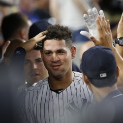 Gary Sanchez of the New York Yankees is welcomed by teammates Saturday after setting a major league record for fastest to 11 career homers – 23 games.