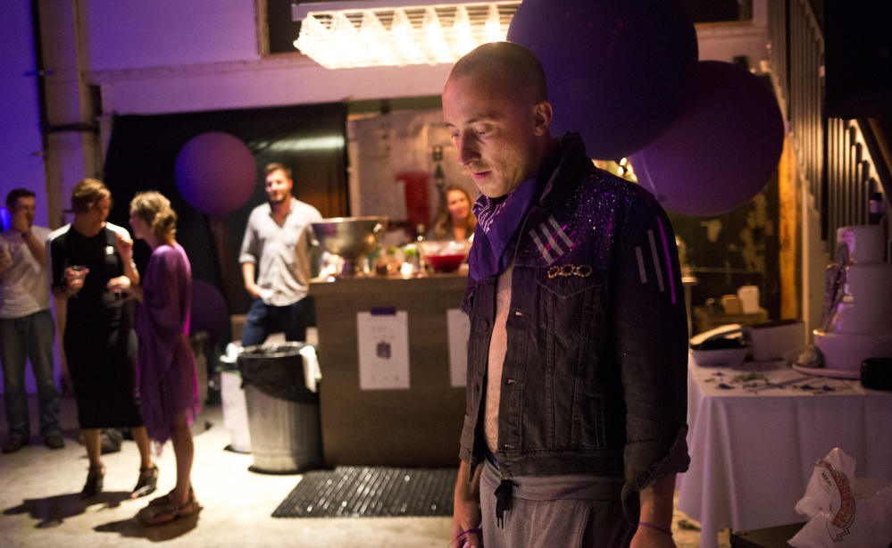 "Sam Koenigsberg pauses after dancing at his 33rd birthday party last week. He threw the celebration partly to bring his friends and family into the world of his ""purple visions."""