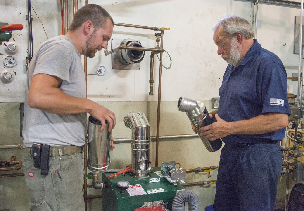 Trevor Rollins, 28, left, discusses options for venting a furnace with senior instructor Bryan Champagne. Rollins already works in HVAC and enrolled at the technical center to take specific courses to expand his areas of expertise.