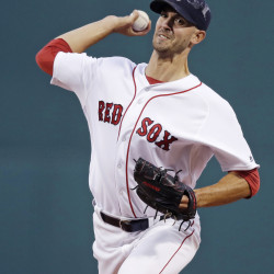 Red Sox starting pitcher Rick Porcello delivers against the Tampa Bay Rays in the first inning Monday night at Fenway Park. Porcello pitched seven innings and won his 18th game of the season.