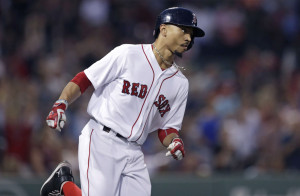 Mookie Betts rounds first base on his solo home run in the second inning, his 30th home run of the season.