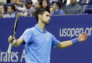 Novak Djokovic said he didn't want to talk about his health, but it was evident that his right arm was a bother Monday night during a four-set victory against Jerzy Janowicz of Poland as the U.S. Open began.