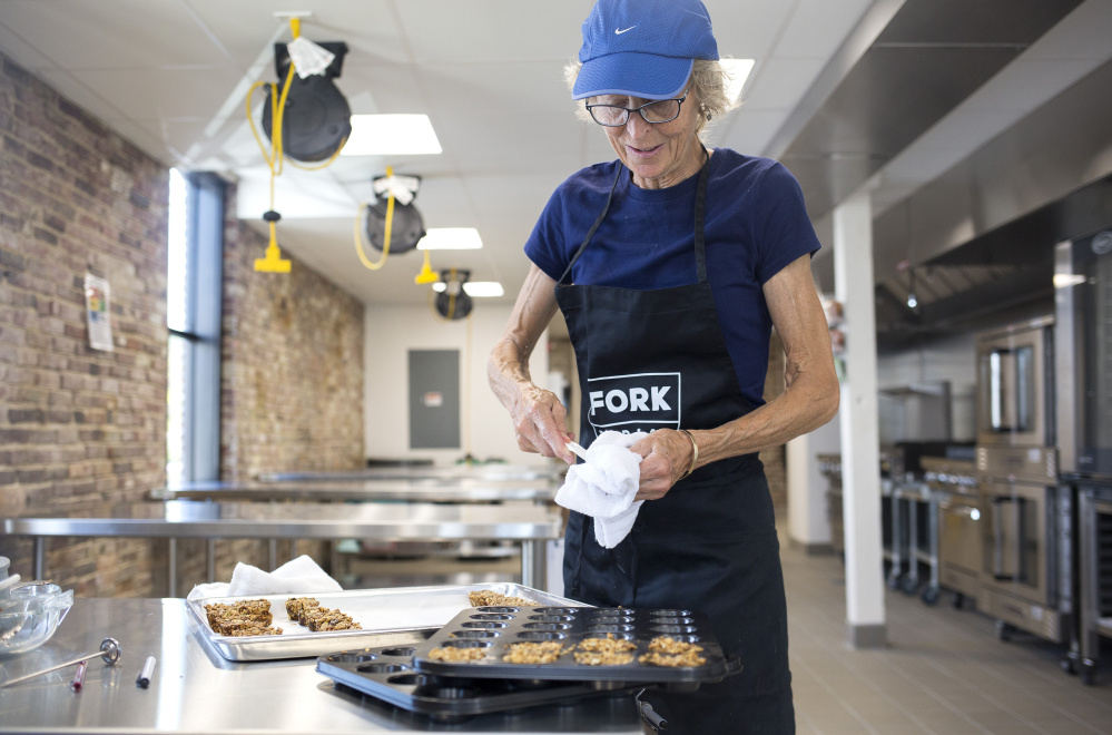 Ellie Tucker works on test batches of her Joyful Spirit granola at Fork Food Lab in Portland. Tucker also plans to market health bars.