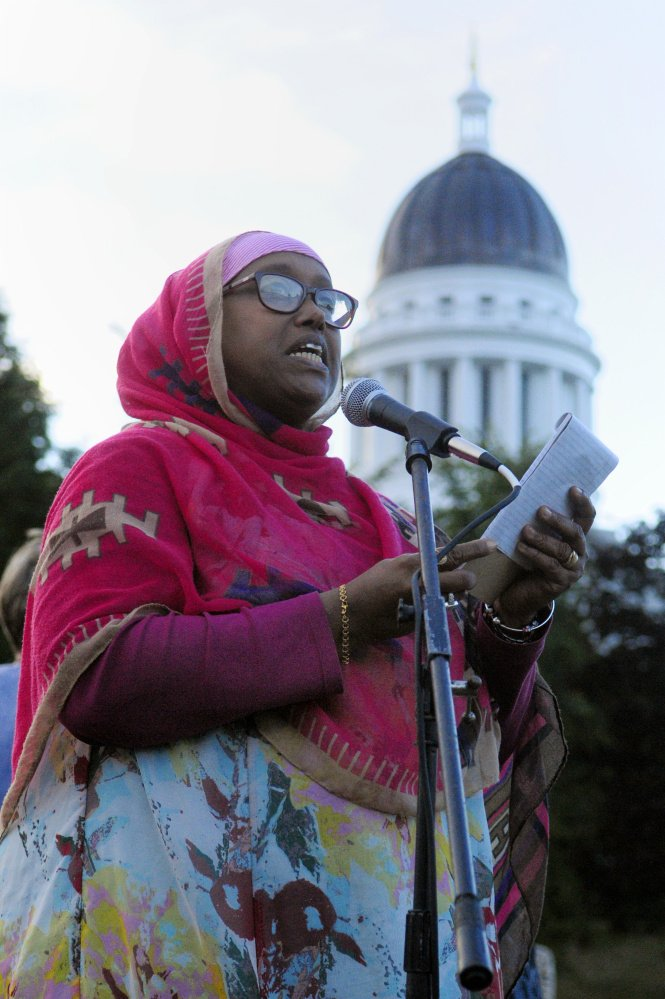 Daqa Dhalac of Lewiston speaks at Tuesday's rally in Capitol Park. She said that as the black, Muslim mother of two sons and a daughter, she fears for their lives.