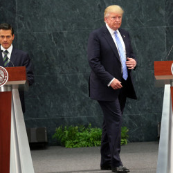 Republican presidential candidate Donald Trump walks to take his place as Mexico's President Enrique Pena Nieto prepares to speak Wednesday during a joint statement at Los Pinos, the presidential official residence in Mexico City.