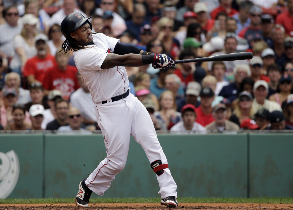 Hanley Ramirez hits a grand slam in the fifth inning Wednesday at Fenway Park, striking the big blow in Boston's 8-6 win over the Tampa Bay Rays.