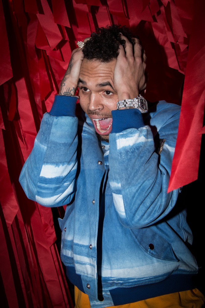 Chris Brown poses for photographers before departing the L'Oreal Red Obsession Party in Paris, Tuesday, March 8, 2016. (AP Photo/Vianney le Caer)