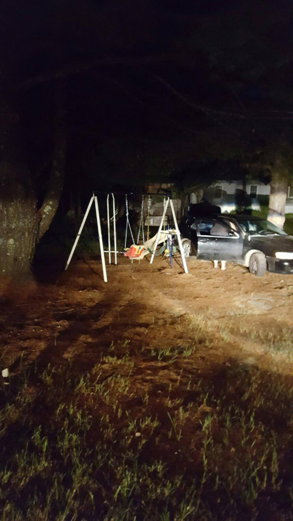 During a police chase on Saturday, a car drove into a yard. (Maine State Police)