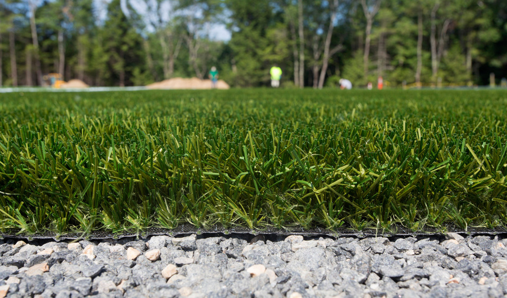 Workers from Northeast Turf, based in Saco, install a new turf field at Massabesic High School in Waterboro.