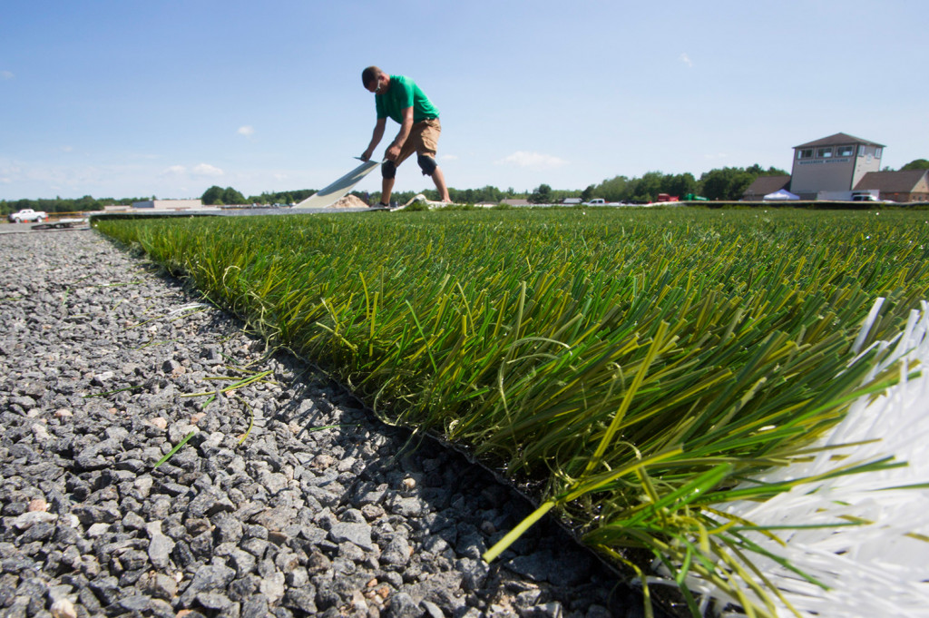 WATERBORO, ME - JULY 20: Dylan Rudolph of Northeast Turf, based in Saco, works on the installation of a new turf field at Massabesic High School in Waterboro on Wednesday, July 20, 2016. (Photo by Derek Davis/Staff Photographer)