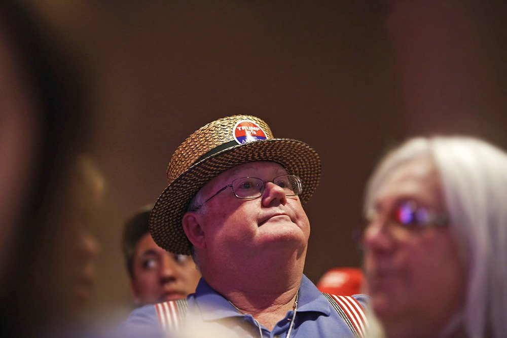 Richard Smith of Litchfield waits to hear presidential candidate Donald Trump speak at Merrill Auditorium Thursday.