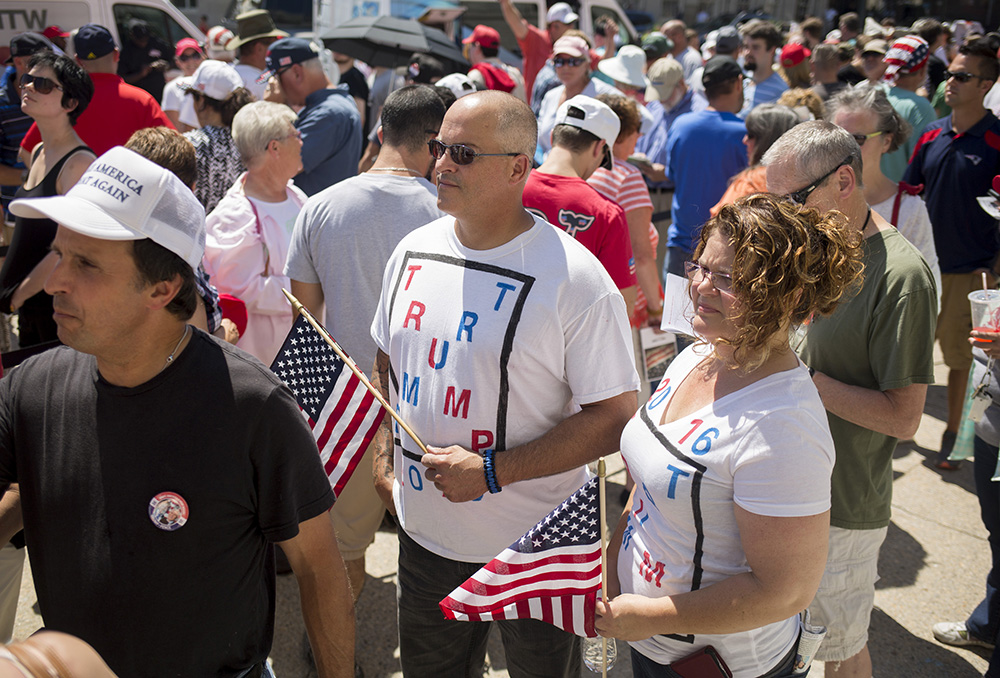 "David Merrill and Connie Smith, of Farmingdale, wear matching Trump shirts as they stand in line for seats inside Merrill Auditorium for the candidate's scheduled 3 p.m. campaign appearance. ""We're here to help make America great again."" Merrill said. Brianna Soukup/Staff Photographer"