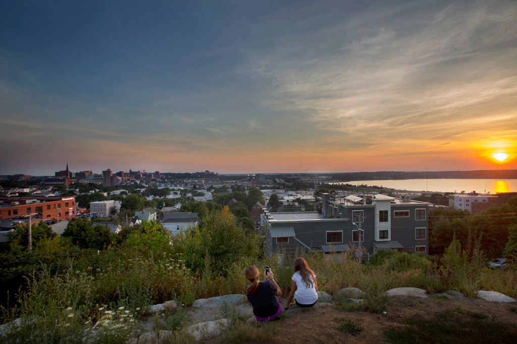 Nicole Hoglund of Portland, left, watches the sunset with her niece Sophia Lanzano on Aug. 12, 2016, from Fort Sumner Park in Portland.