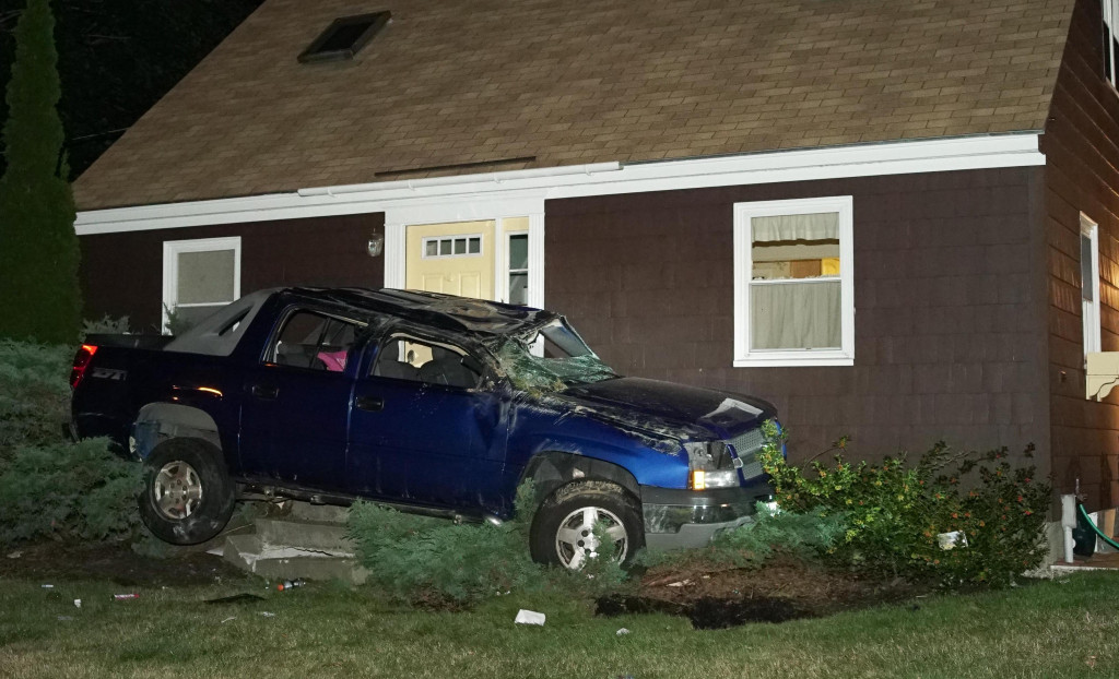 Police searched Friday night for the man who crashed this Chevrolet SUV into a house in Yarmouth after a police chase. Photo by Tom Bell