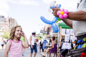Emery Lubitz, 5, of Newton, Mass., looks on as Jeff Dorian, a balloon artist from Fort Lauderdale, Fla., makes a dog for her during the annual downtown art walk on Congress Street in downtown Portland Saturday, August 27, 2016.