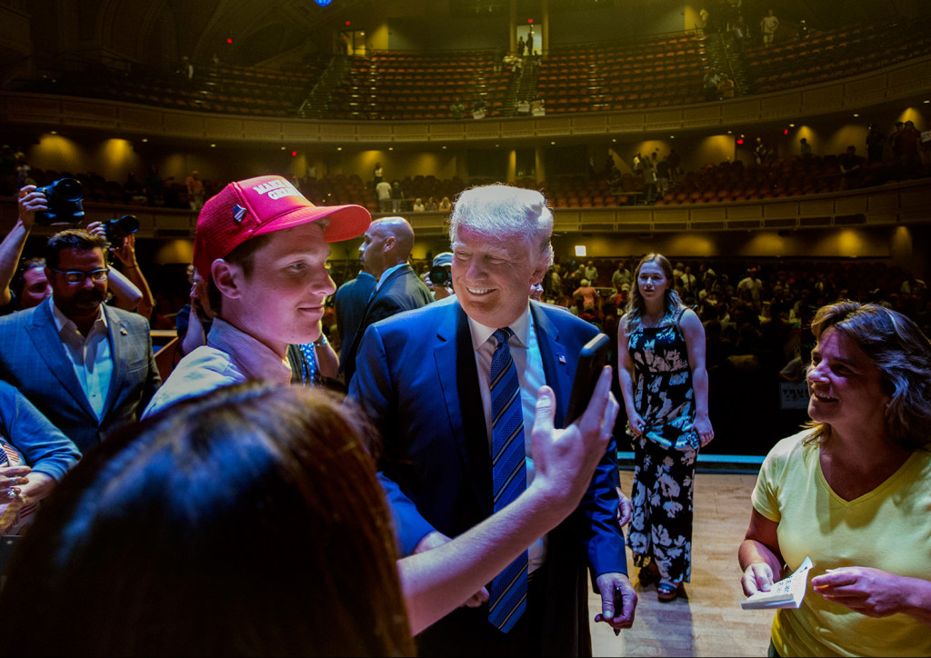 "Connor Mullen, a South Portland High School student, takes a ""selfie"" with Donald Trump at Merrill Auditorium."